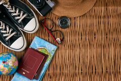 Summer vacation, travel, tourism and objects concept. Passport travel document photo camera sunglasses globe map, top view. Traveler items vacation travel Stock Photos
