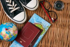 Summer vacation, travel, tourism and objects concept. Passport travel document photo camera sunglasses globe map, top view. Traveler items vacation travel Stock Images