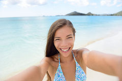 Summer vacation travel woman making selfie beach. Summer vacation beach travel. Technology and people concept with smiling woman making selfie with smartphone on Royalty Free Stock Images