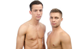 Summer, vacation. Two guys. Love and relationships. White background. Gay couple. Passion, sexuality and love. Two attractive young men. White background stock photo