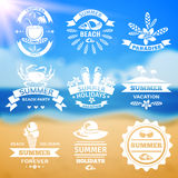 Summer vacation typography emblems labels set. Summer vacation travel agency resorts emblems labels collection typography with ocean beach background abstract Stock Photos