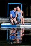 Happy married couple in marina with paddle board floating on water. Summer vacation in Vancouver. British Columbia. Canada stock images