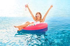 Summer Vacation. Woman in bikini on the inflatable donut mattress in the SPA swimming pool. Summer Vacation. Enjoying suntan Woman in bikini on the inflatable royalty free stock images