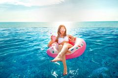 Summer Vacation. Woman in bikini on the inflatable donut mattress in the SPA swimming pool. Summer Vacation. Enjoying suntan Woman in bikini on the inflatable stock photos