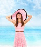 Summer vacation woman pink dreess hat Stock Photos