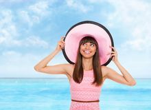Summer vacation woman pink dreess hat Royalty Free Stock Images