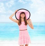 Summer vacation woman pink dreess hat Royalty Free Stock Photos