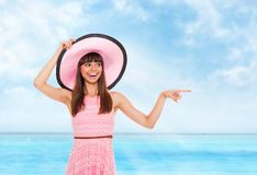Summer vacation woman pink dreess hat Stock Photography