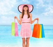 Summer vacation woman pink dreess hat Royalty Free Stock Image