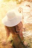 Summer vacation woman sitting on beach enjoying summer holidays Royalty Free Stock Images