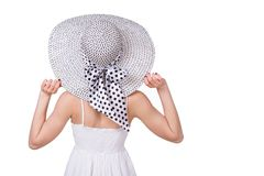 Summer vacation woman sitting holding beach hat Royalty Free Stock Photo