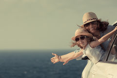 Summer vacations concept. Woman and child at the beach. Summer vacations concept stock photos