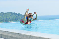 Summer vacations , Happy mother and daughter playing in b Royalty Free Stock Image