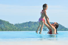 Summer vacations Happy mother and daughter playing in b Royalty Free Stock Images