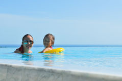 Summer vacations Happy mother and daughter playing Stock Photography