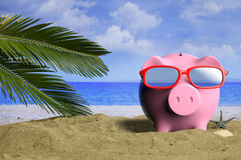 Summer vacations - Piggy bank on a sandy beach. 3d illustration Royalty Free Stock Photography