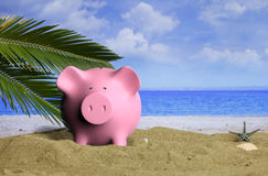 Summer vacations - Piggy bank on a sandy beach. 3d illustration Stock Image