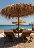 Summer Vacations - Sun ubrellas under the hot sun Stock Photography