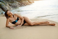 Summer Vacations. Woman Lying On Beach. Healthy Lifestyle. Trave Royalty Free Stock Photos