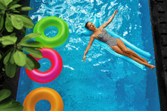 Summer Vacations. Woman Sunbathing, Floating In Swimming Pool Water Royalty Free Stock Image
