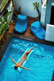 Summer Vacations. Woman Sunbathing, Floating In Swimming Pool Water Stock Images