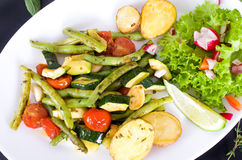 Summer vegetable pan with baked potatoes Stock Photos