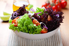 Summer vegetable salad on kitchen table Stock Photos