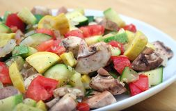 Summer Vegetable Skillet. Skillet of Mixed Vegetables on a White Platter Stock Image