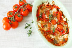 Summer vegetables baked meal. Bouyourdi - Greek main dish with feta cheese , red pepper and tomatoes Royalty Free Stock Photos