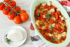 Summer vegetables baked meal. Bouyourdi - Greek main dish with feta cheese , red pepper and tomatoes Royalty Free Stock Photo