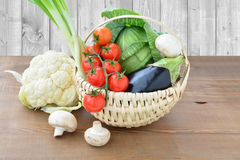 Summer vegetables in a basket Stock Photos