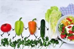 Summer vegetables go to salad Stock Image