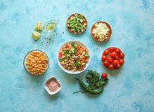 Summer vegetarian diet. Salad with chickpeas and vegetables on a blue table. Summer vegetarian diet. Salad with chickpeas and vegetables on a blue table Stock Photography