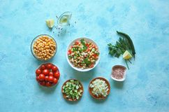 Summer vegetarian diet. Salad with chickpeas and vegetables on a blue table. Summer vegetarian diet. Salad with chickpeas and vegetables on a blue table Stock Photos