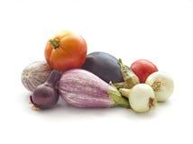 Summer veggies on white. Summer veggies tomates, eggplants, Onion  on white Stock Images