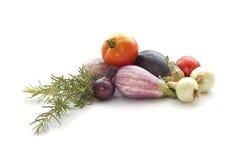 Summer veggies on white. Summer veggies tomates, eggplants, Onion isolated on white Royalty Free Stock Image