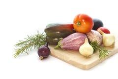 Summer veggies with wodden cutting board on white. Summer veggies tomates, eggplants, Onion on wooden cutting board  on white Royalty Free Stock Photos