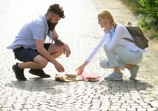 Summer vibes. Hipster helping and looking at girl. Couple in love. Man and woman falling in love. Bearded man and. Summer vibes. Hipster helping and looking at royalty free stock images