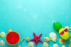 Sea shells and bright squishy toys frame, top view copy space. Summer vibrant blue  backdrop with sea shells and bright squishy toys frame, top view copy space stock image