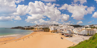 Summer view of Albufeira beach fishermen. Royalty Free Stock Image