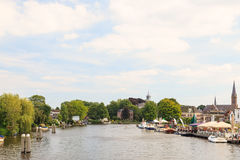 Summer view of the Amstel river with houses and boats in the sma Royalty Free Stock Photo