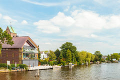 Summer view of the Amstel river with houses and boats in the sma Stock Photos