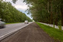 Blurred cars on road going to far away royalty free stock photography