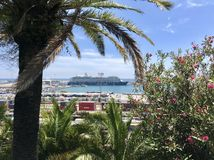 Summer view of Barcelona City with sea, ship, palm trees and flowers. Beautiful peaceful view of Barcelona, Spain with sea, ship, sky, trees and flowers stock photo