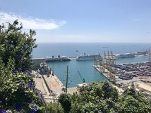 Summer view of Barcelona City with sea, ship, trees and flowers. Beautiful peaceful view of Barcelona, Spain with sea, ship, sky, trees and flowers royalty free stock photos