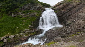 Summer view of beautiful cascade waterfall in the mountains. Beautiful view of cascade waterfall in Mountain Range Vachkazhets. Summer mountain landscape of stock video footage