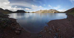 Summer view of crater lake of active Khangar Volcano on Kamchatka Peninsula Royalty Free Stock Images