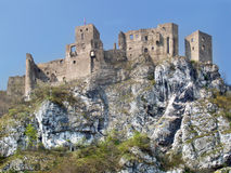 Summer view of ruined Strecno Castle. Summer view of famous Strecno Castle ruin sitting on massive rock formation located above the Varin village. This castle is royalty free stock images