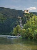 Ferry on Vah river and The Strecno Castle royalty free stock images