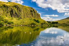 Summer view of the hill reflected in a lake Royalty Free Stock Images
